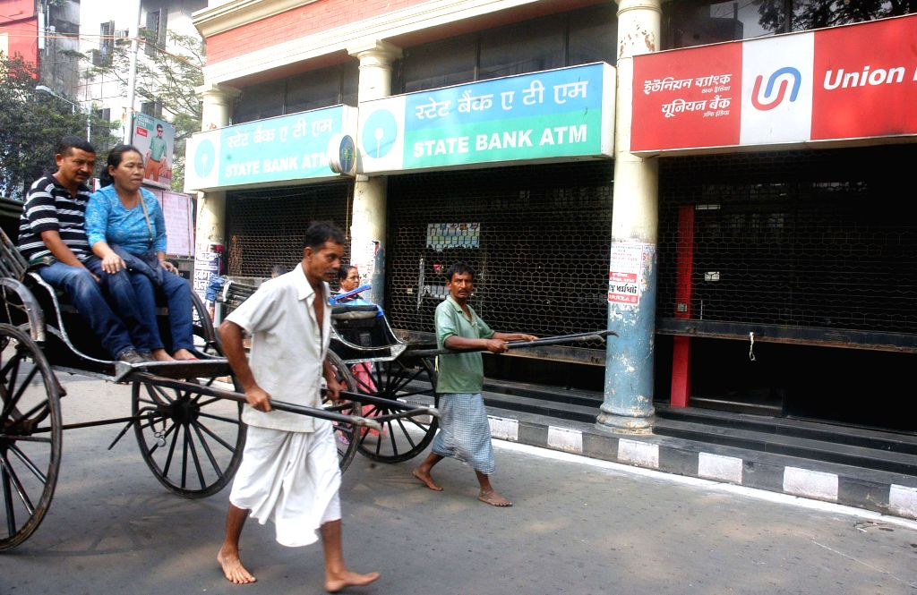 ATMs remain shut during a two-day nationwide strike called by bank employees in Kolkata on Dec 4, 2014.