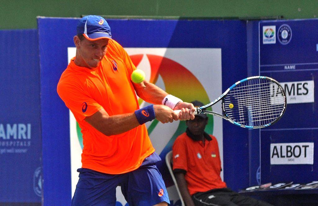 Australian tennis player James Duckworth in action against Radu Albot of Moldova during an Emami Kolkata Open 2015- ATP Challenger final match in Kolkata on Feb 28, 2015. Radu Albot won ...