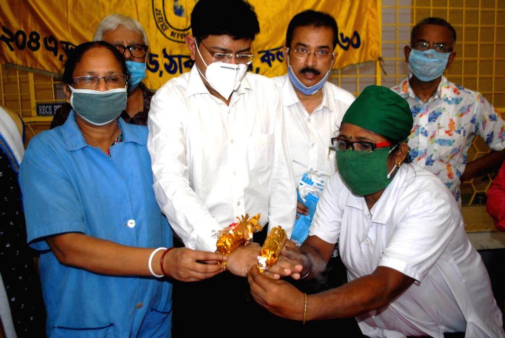Kolkata : Automatic sanitiser rakhi launched at Thakurpukur Swadesh Basu Hospital for the safety of their health workers during COVID 19 pandemic ahead of Raksha Bandhan, in Kolkata on Aug 2, 2020.
