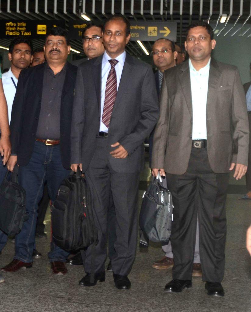 Bangladeshi intelligence officials arrive at Netaji Subhas Chandra Bose International Airport in Kolkata on Nov 27, 2014.