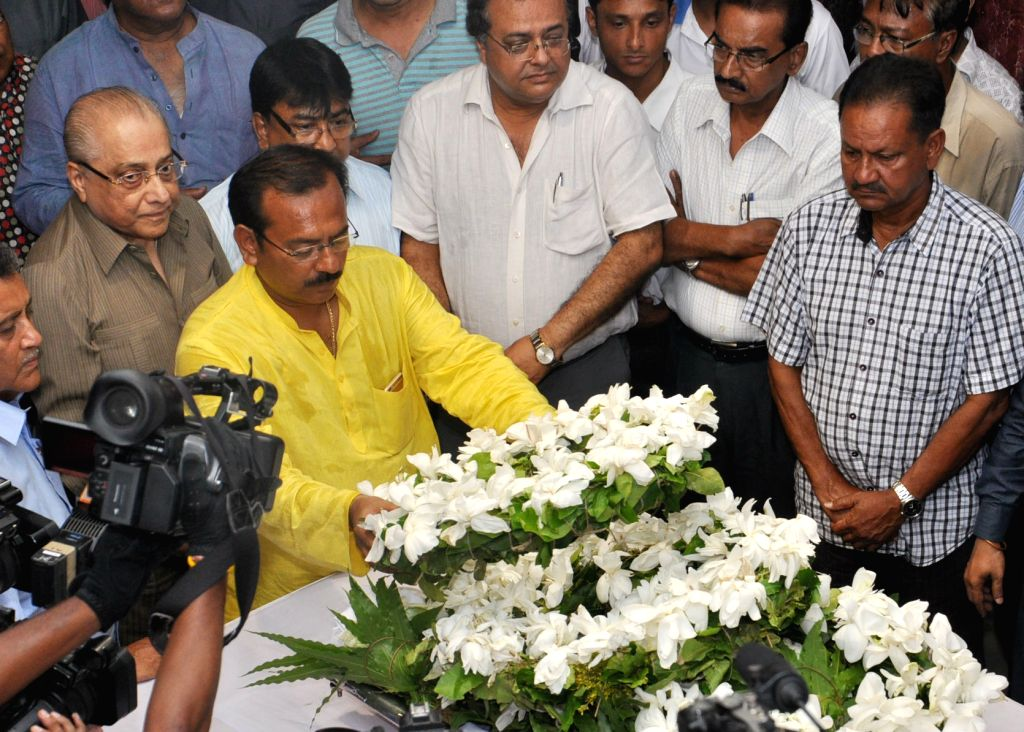 BCCI president Jagmohan Dalmiya and West Bengal Housing Minister Arup Biswas pay tribute to former Bengal Under-19 captain Ankit Kesri who succumbed to a head injury on April 20, 2015. He ... - Arup Biswas