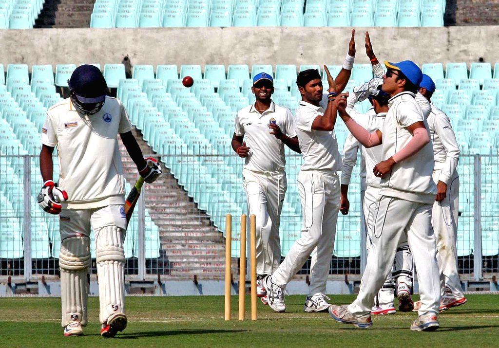 Bengal player Ashok Dinda celebrates fall of a wicket during a Ranji Trophy match against Tamil Nadu at Eden Garden in Kolkata on Jan. 5, 2014.