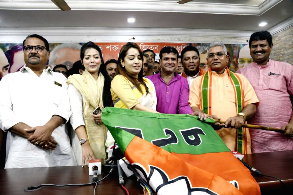 Kolkata: Bengali actress Rimjhim Mitra joins BJP in the presence of West Bengal BJP President Dilip Ghosh at party headquartes in Kolkata, on 21 July 2019. (Photo: IANS) - Rimjhim Mitra and Dilip Ghosh