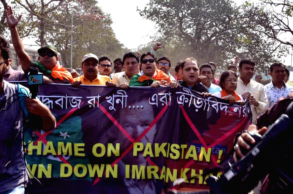 Kolkata: Bhartiya Janta Yuva Morcha (BJYM) activists stage a demonstration outside Eden Gardens to demand removal of pictures of Pakistani cricketers including Pakistan Prime Minister Imran Khan; in Kolkata on Feb 23, 2019. (Photo: IANS) - Imran Khan
