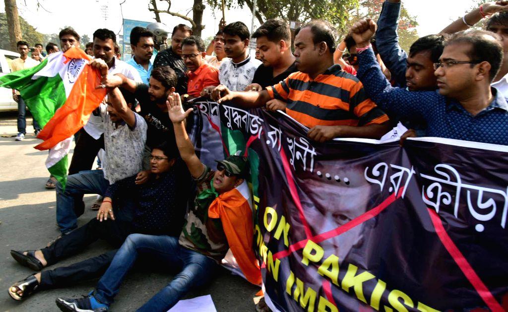 Kolkata: Bhartiya Janta Yuva Morcha (BJYM) activists stage a demonstration outside Eden Gardens to demand removal of pictures of Pakistani cricketers including Pakistan Prime Minister Imran Khan; in Kolkata on Feb 23, 2019. (Photo: IANS) - Imran Khan