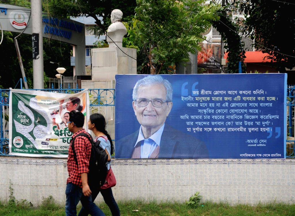 Kolkata: Billboards with photographs of Nobel laureate Amartya Sen containing his remarks dubbing the 'Jai Sri Ram' slogan as alien to Bengali culture and being used to beat up people that have appeared  in Kolkata streets on July 12, 2019. (Photo: K