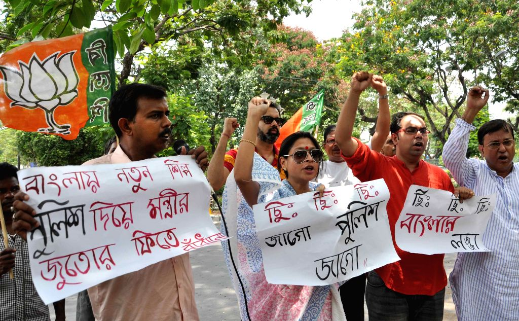BJP activists demonstrating near West Bengal Minister Rachpal Singh's house protesting his action of letting a security guard tie his shoelaces in Kolkata on May 26, 2015.