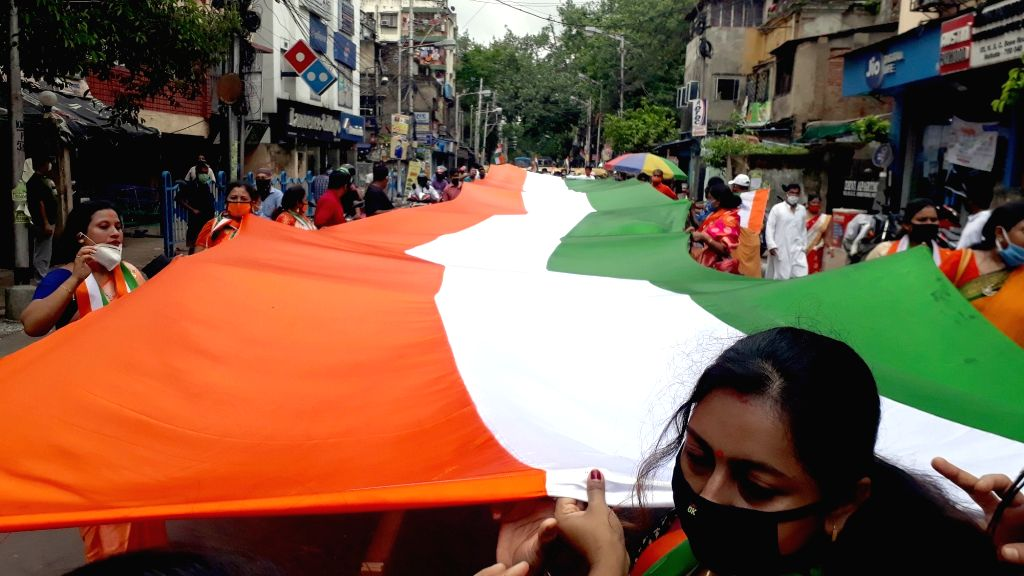 Kolkata : BJP activists participate in a rally carrying 330ft long tricolor on the occasion of the 74th Independence Day, in Kolkata on Aug 15, 2020.