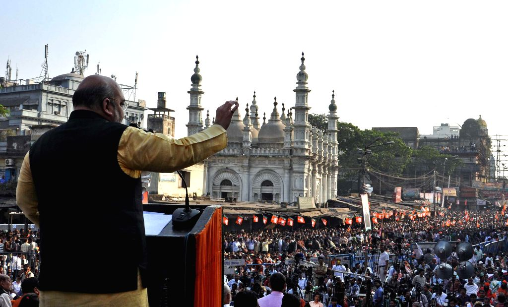 BJP chief Amit Shah addresses during a BJP rally in Kolkata, on Nov 30, 2014.