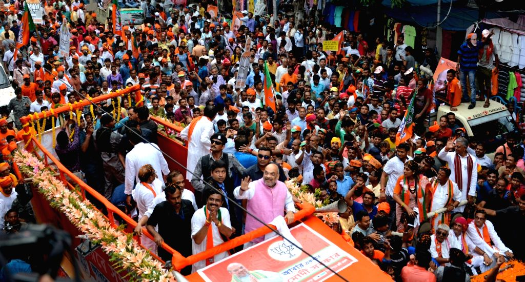 Kolkata: BJP chief Amit Shah during a roadshow ahead of the final phase of 2019 Lok Sabha elections, in Kolkata on May 14 2019. (Photo: IANS) - Amit Shah