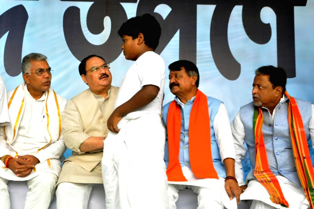 Kolkata: BJP leaders J.P. Nadda, Dilip Ghosh, Kailash Vijayvargiya and Mukul Roy offer 'Tarpan' to the souls of deceased party workers who had lost their lives in the political violence that had erupted in West Bengal; in Kolkata on Sep 28, 2019. (Ph - Dilip Ghosh and Mukul Roy