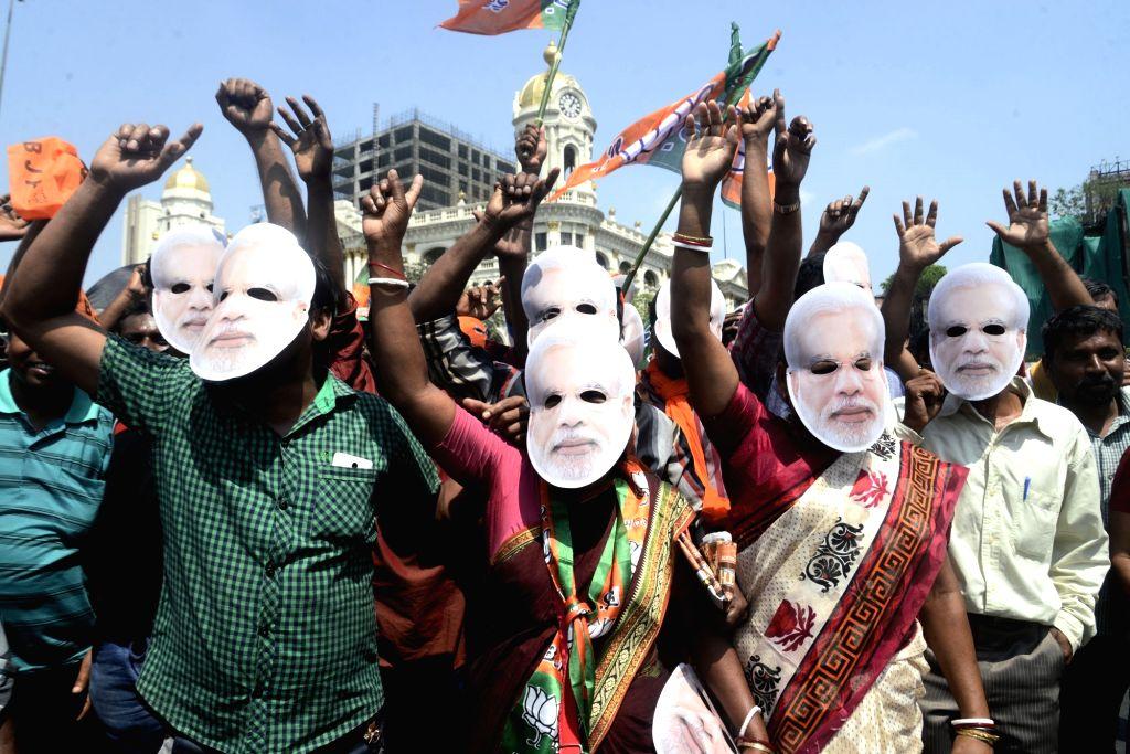 Kolkata: BJP supporters arrive to participate in Prime Minister and party leader Narendra Modi's public rally at Brigade Parade Ground in Kolkata, on April 3, 2019. (Photo: IANS) - Narendra Modi