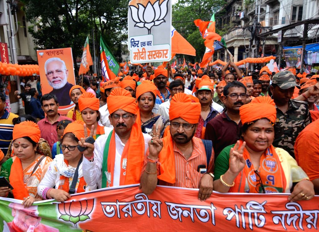 Kolkata: BJP supporters participate in party chief Amit Shah's road show in Kolkata on May 14, 2019. (Photo: IANS) - Amit Shah
