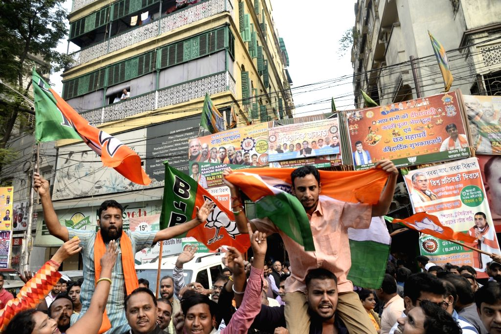Kolkata: BJP workers celebrate after the Citizenship Amendment Bill (CAB) 2019 was passed in Parliament on Wednesday; in Kolkata on Dec 12, 2019. (Photo: IANS)