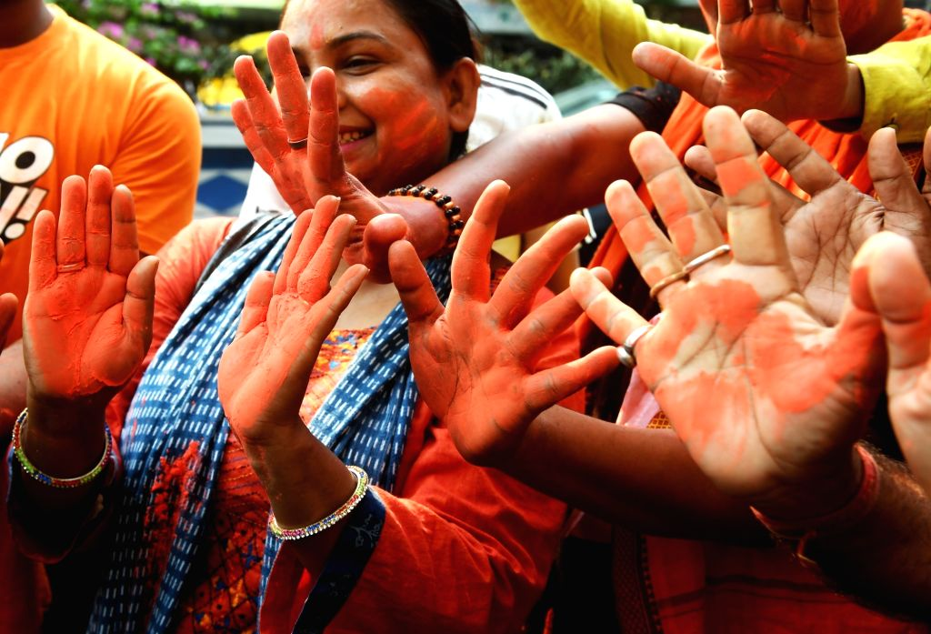 Kolkata: BJP workers celebrate after the party led by Prime Minister Narendra Modi is set to retain power for another five years after making a sweep of the 2019 Lok Sabha battle and mauling the opposition; in Kolkata, on May 23, 2019. (Photo: Kuntal - Narendra Modi