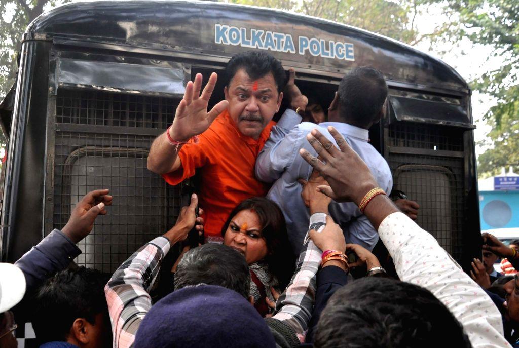 Kolkata: BJP workers protesting against Kumarganj rape case, being detained in Kolkata on Jan 10, 2020. (Photo: Kuntal Chakrabarty/IANS)