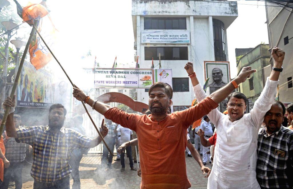 Kolkata: BJP workers stage a demonstration against Congress leader Rahul Gandhi, demanding his apology for his remarks on Rafale verdict, outside the Congress office in Kolkata on Nov 16, 2019. (Photo: Kuntal Chakrabarty/IANS) - Rahul Gandhi