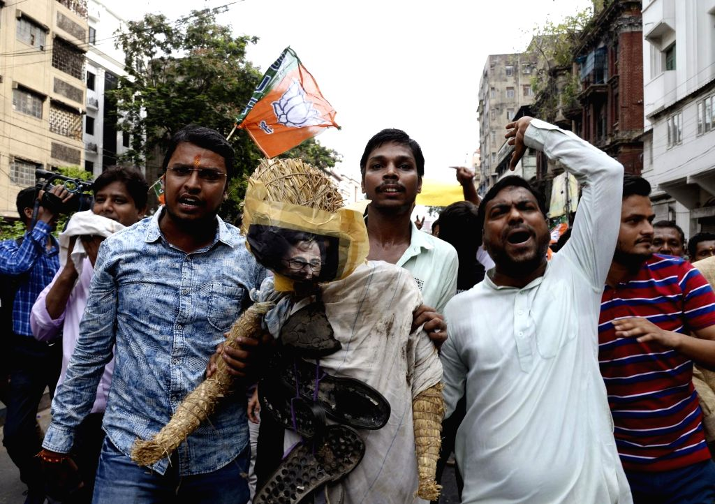 Kolkata: BJP workers stage a demonstration against the alleged killing of  party workers during a clash between the saffron outfit and the ruling Trinamool Congress at Sandeshkhali, in West Bengal's North 24 Parganas; in Kolkata on June 9, 2019. (Pho
