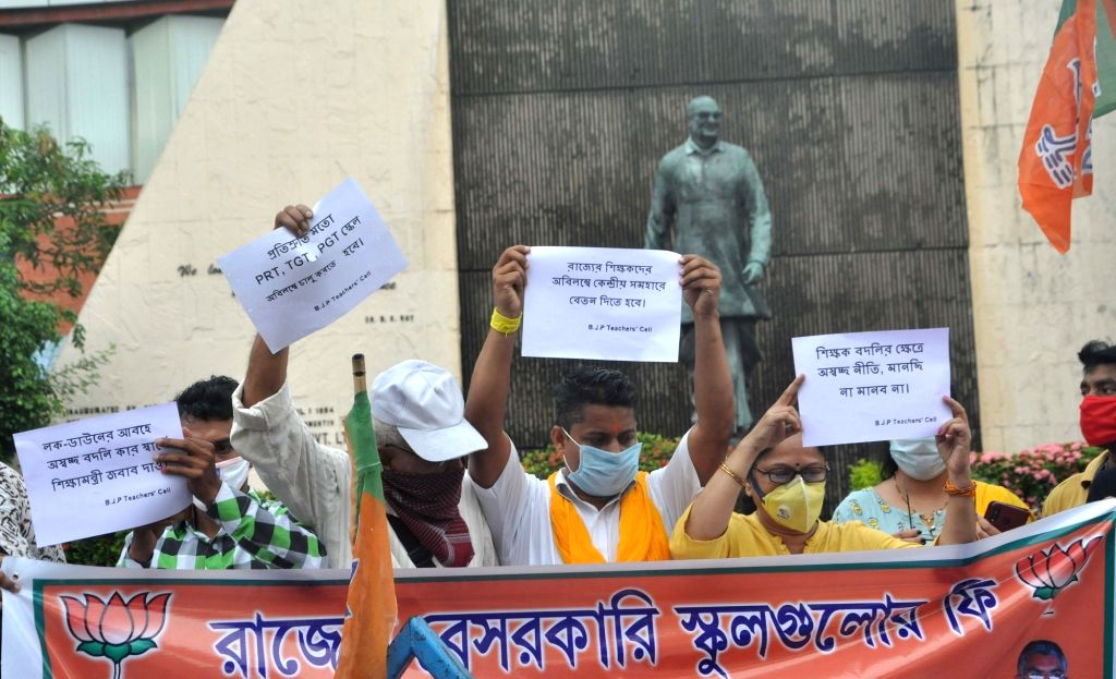 Kolkata: BJP workers stage a demonstration to protest against a hike in school fee and charging of fee from parents in the COVID-19 lockdown period by private schools, near Bikash Bhavan in Kolkata on June 15, 2020. (Photo: Kuntal Chakrabarty/IANS)