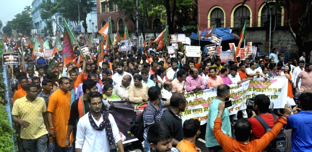 Kolkata: BJP Yuva Morcha workers stage a demonstration against hike in electricity bills in Kolkata on Sep 11, 2019. (Photo: IANS)