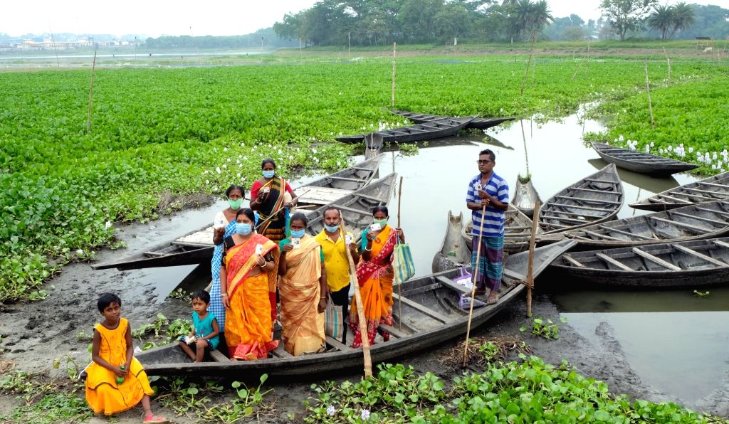 Kolkata  : Bongaon, 22nd April 2021 : Family members of 'Teroghara' (Thirteen Family of Indian Citizen) resides in Bangladesh coming to cast their votes at 'Piroja' polling booth of Bongaon during ...