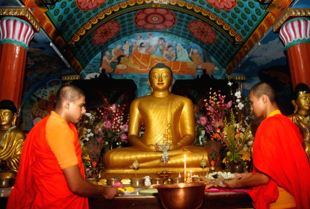 Buddhist monks pay obeisance at a temple on the eve of `Buddha Purnima` in Kolkata, on May 3, 2015.