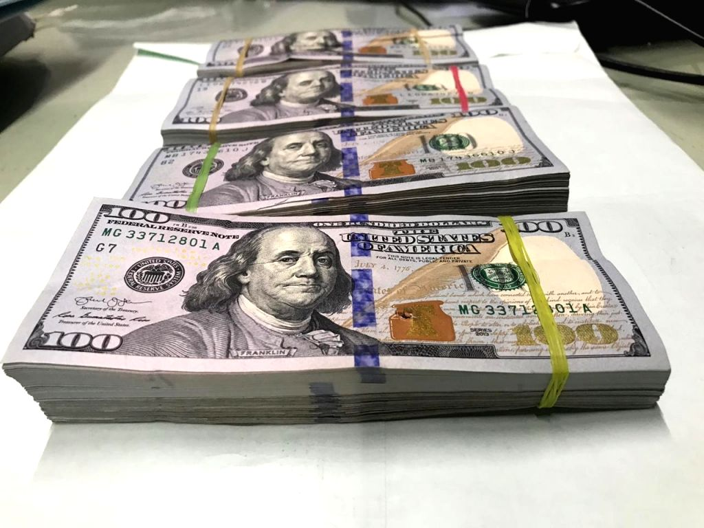 : Kolkata: Bundles of foreign currency notes that were recovered by the Directorate of Revenue Intelligence (DRI) from a syndicate involved in smuggling foreign currency out of the country at Netaji ...