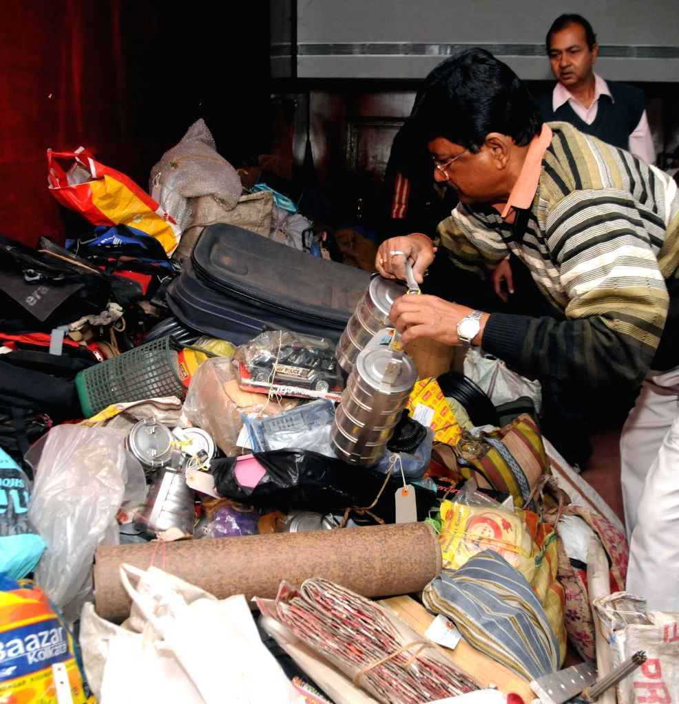 Calcutta Tramways Company officials auction `lost and found items` that were not claimed by anyone in Kolkata on Jan 21, 2015. The items included tiffin careers, umbrellas toys etc.