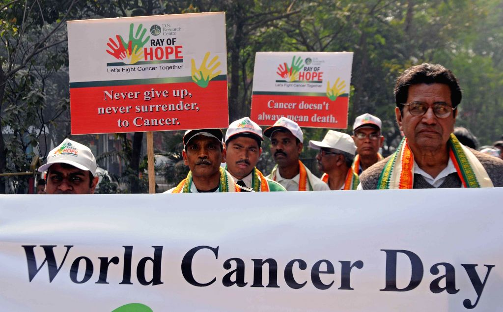 Cancer survivors participate in a awareness rally during World Cancer Day in Kolkata on Feb. 4, 2015.