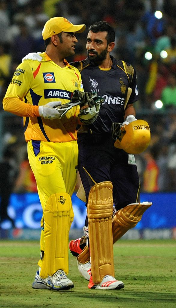 Chennai Super Kings captain MS Dhoni and Kolkata Knight Riders player  Robin Uthappa during an IPL-2015 match between Chennai Super Kings and Kolkata Knight Riders at Eden Gardens in ... - MS Dhoni