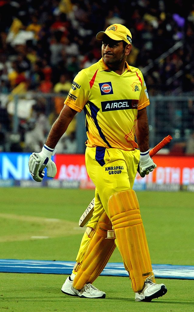 Chennai Super Kings player captain MS Dhoni returns back to the pavilion after getting dismissed during an IPL-2015 match between Chennai Super Kings and Kolkata Knight Riders in Kolkata, on ... - MS Dhoni