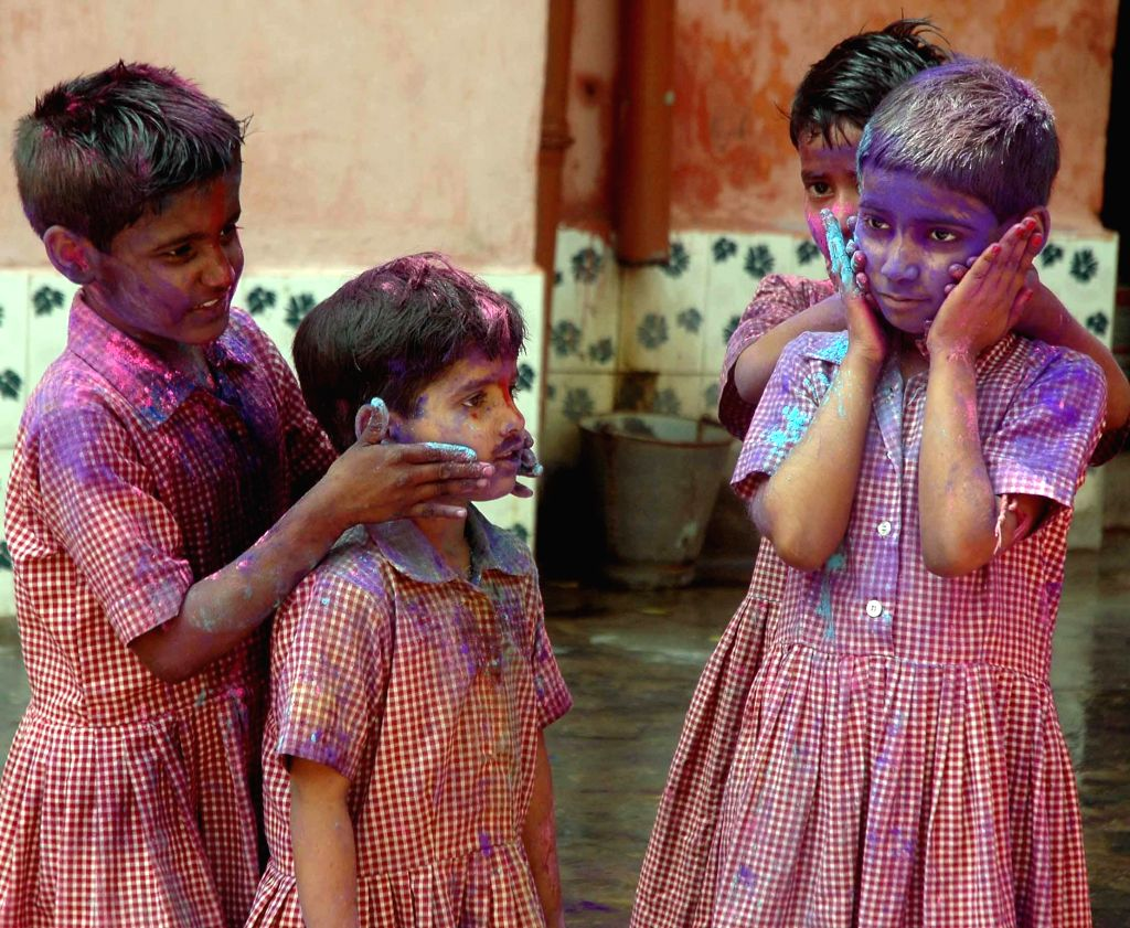 Children celebrate holi in Kolkata, on March 4, 2015.