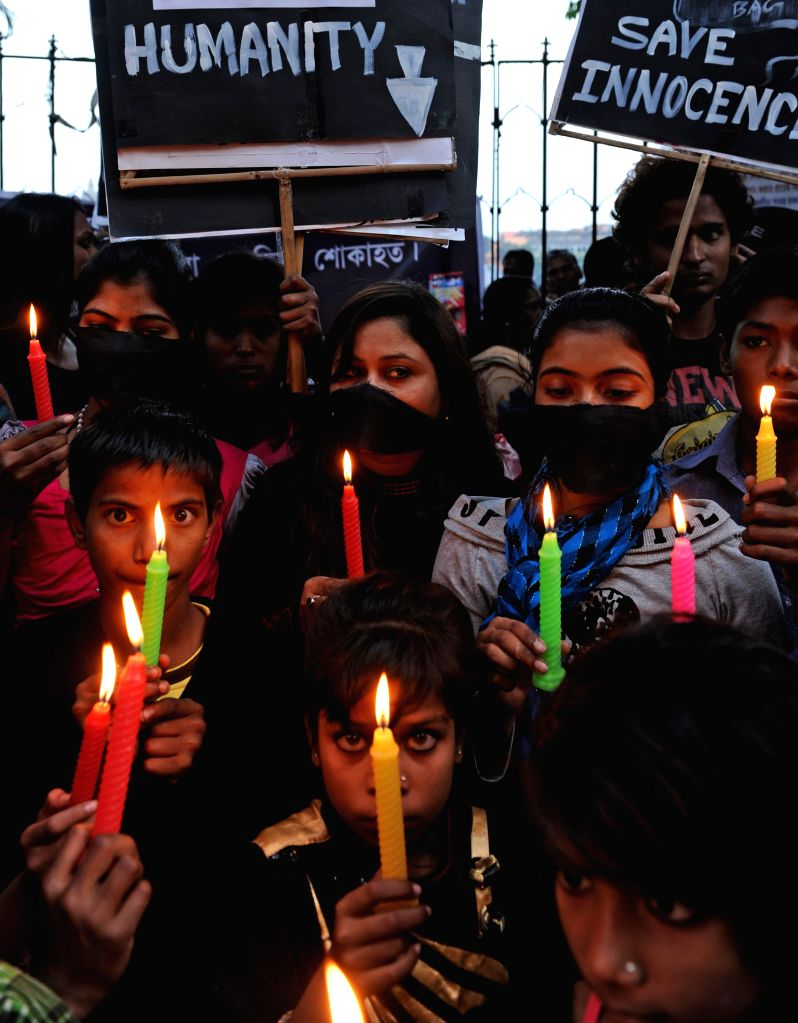 Children participate in a rally to condemn recent attack on a Peshawar school that left 148 dead, mostly children, at Shobhabazar in Kolkata, on Dec 20, 2014.