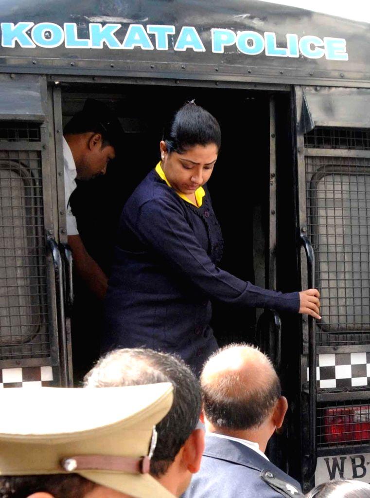 Close aide of Saradha scam kingpin Sudipta Sen, Debjani Mukherjee being taken to be produced at a Kolkata court in connection with multi-crore-rupee Sardha chit fund scam on Jan 2, 2015.
