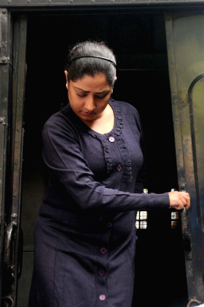 Close aide of Saradha scam kingpin Sudipta Sen, Debjani Mukherjee being taken to be produced at a Kolkata court in connection with multi-crore-rupee Sardha chit fund scam on Jan 3, 2015.
