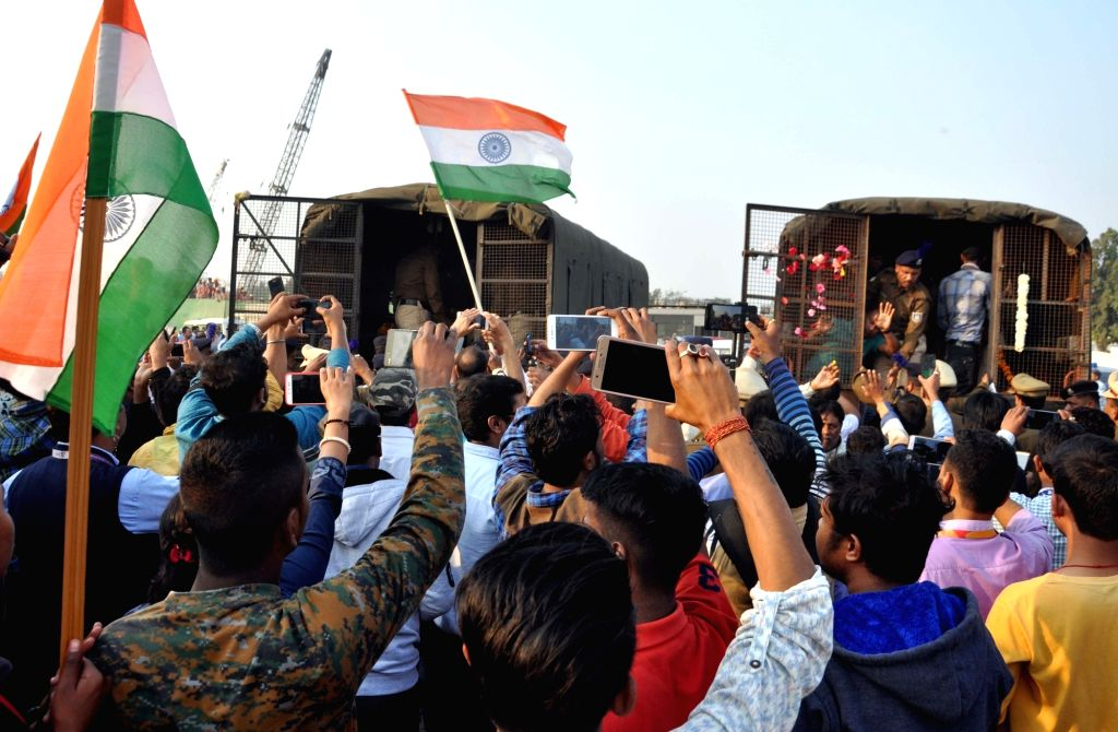 Kolkata: Coffins of martyrs Bablu Santra and Sudip Biswas, who were among the 49 CRPF men killed in 14 Feb Pulwama militant attack, being loaded to be taken to their native places in Kolkata on Feb 16, 2019. (Photo: Kuntal Chakrabarty/IANS)