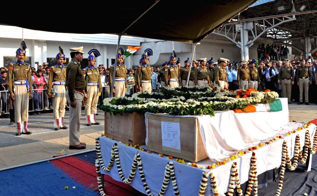 Kolkata: Coffins of martyrs Bablu Santra and Sudip Biswaws, who were among the 49 CRPF men killed in 14 Feb Pulwama militant attack arrive at Netaji Subhas Chandra Bose International Airport in Kolkata on Feb 16, 2019. (Photo: Kuntal Chakrabarty/IANS