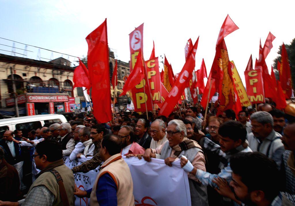 CPI(M) activists protest against Trinamool Congress in Kolkata on Dec 13, 2014.