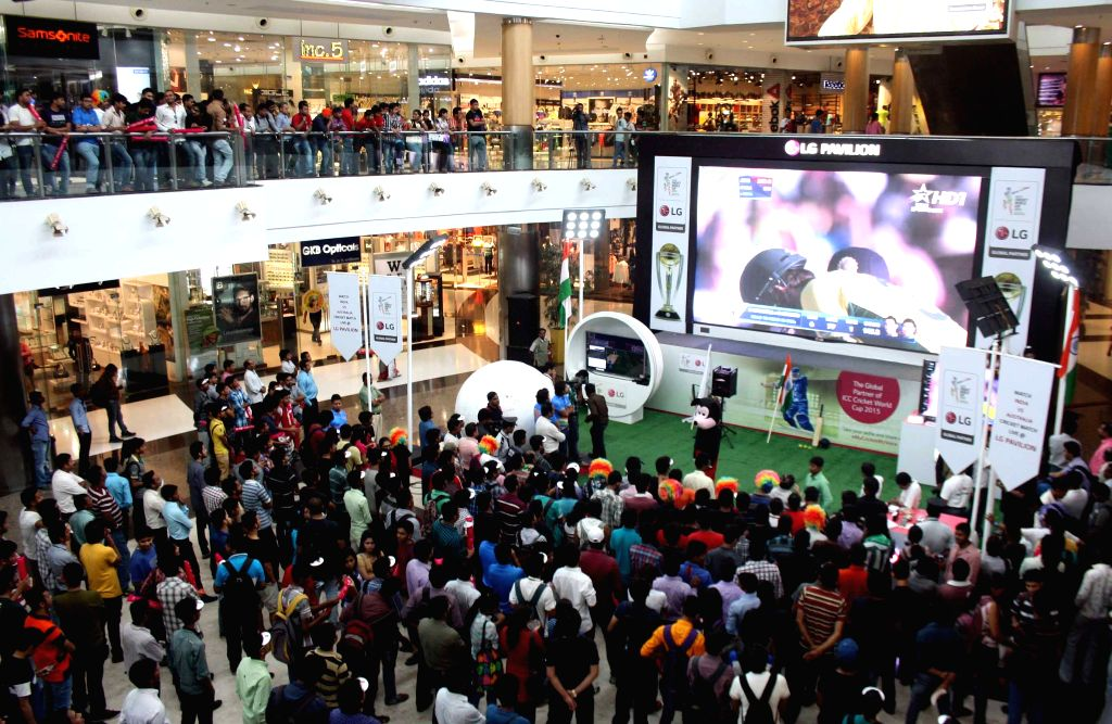 Cricket fans glued to a giant screen set-up at a Kolkata shopping mall during the semifinal match of ICC World Cup 2015 between India and Australia in Sydney; on March 26, 2015.