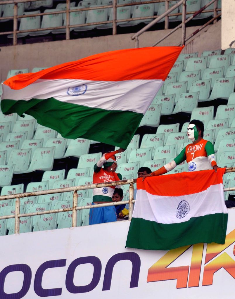 Cricket fans wave Indian flag at the Eden Gardens ahead of the 4th ODI between India and Sri Lanka on Nov 13, 2014.