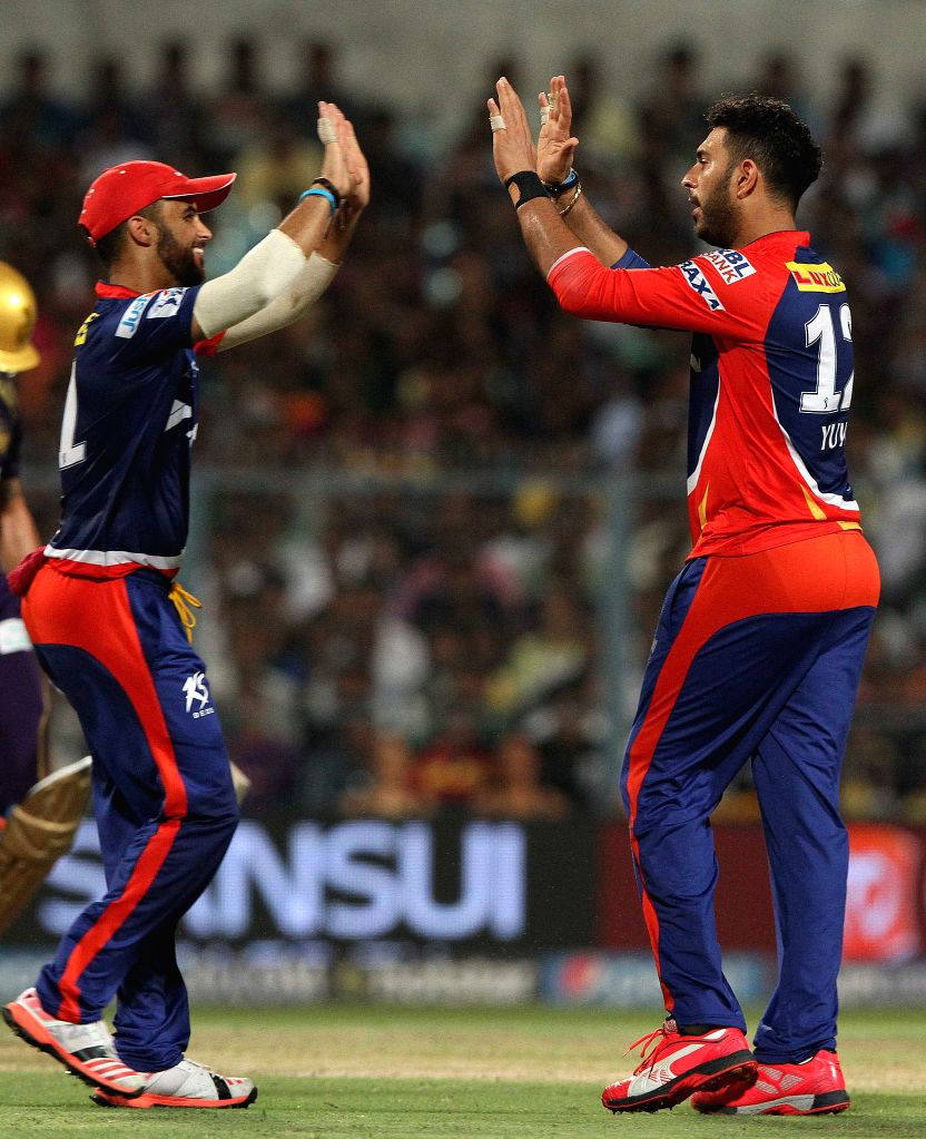 Delhi Daredevils bowler Yuvraj Singh celebrates fall of Manish Pandey's wicket during an IPL -2015 match between Delhi Daredevils and Kolkata Knight Riders at the Eden Gardens in Kolkata, on ... - Yuvraj Singh and Manish Pandey
