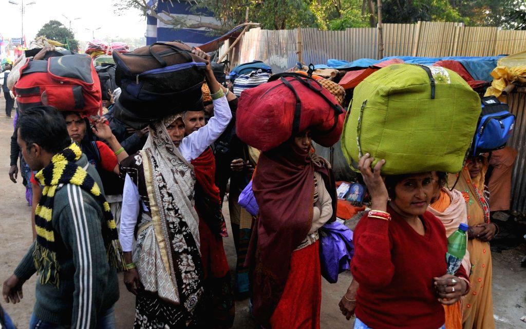 Kolkata: Devotees on their way to the Gangasagar Mela, arrive at Babughat transit camp in Kolkata on Jan 14, 2020. (Photo: Kuntal Chakrabarty/IANS)