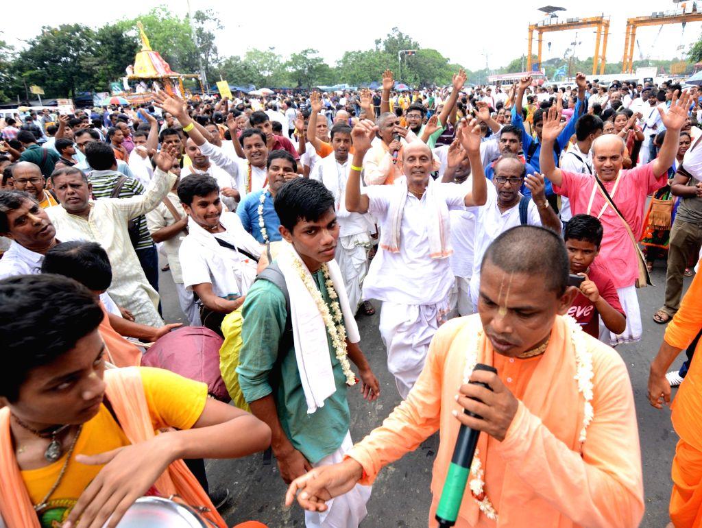 Kolkata: Devotees participate in Bahuda Yatra-the home coming of Lord Jagannath, Lord Balabhadra, Lord Sudarshan and Devi Subhadra from Gundicha Temple to Srimandir; in Kolkata on July 12, 2019. (Photo: Kuntal Chakrabarty/IANS)