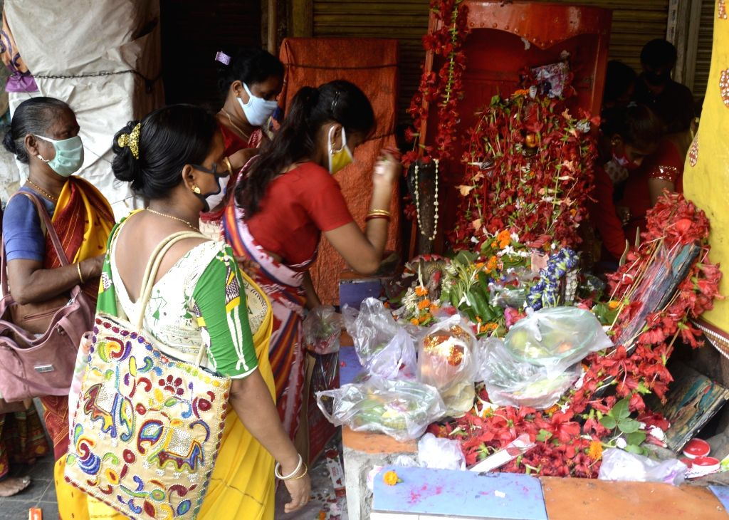 Kolkata: Devotees perform rituals during Bipodtarini puja at the Kalighat Kali temple that reopened today, amid Unlock 1.0 or phased relaxation during the fifth phase of the nationwide lockdown imposed to mitigate the spread of coronavirus, in Kolkat