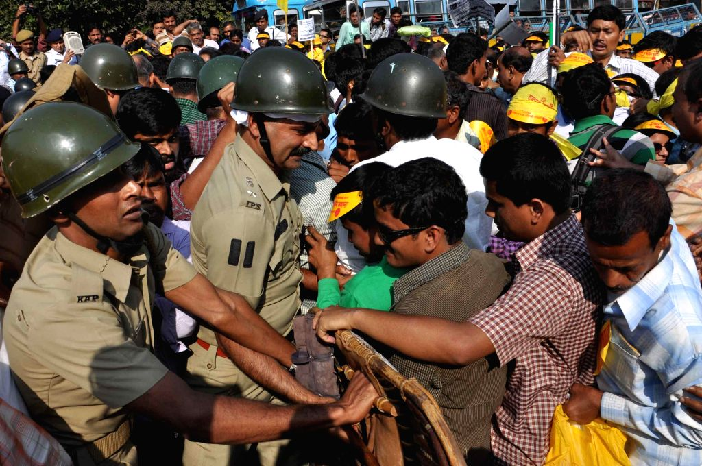 Differently-able people clash with police during a demonstration organised on `International Day for Persons with Disabilities` in Kolkata, on Dec 3, 2014.