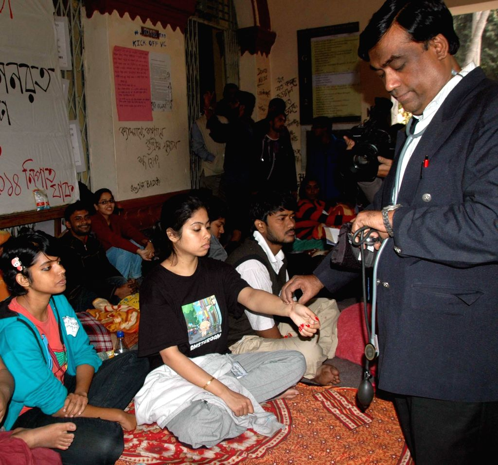 Doctors carry out medical tests on Jadavpur University students who are on a hunger strike to press for the removal of vice chancellor Abhijit Chakrabarti at the university campus in ...