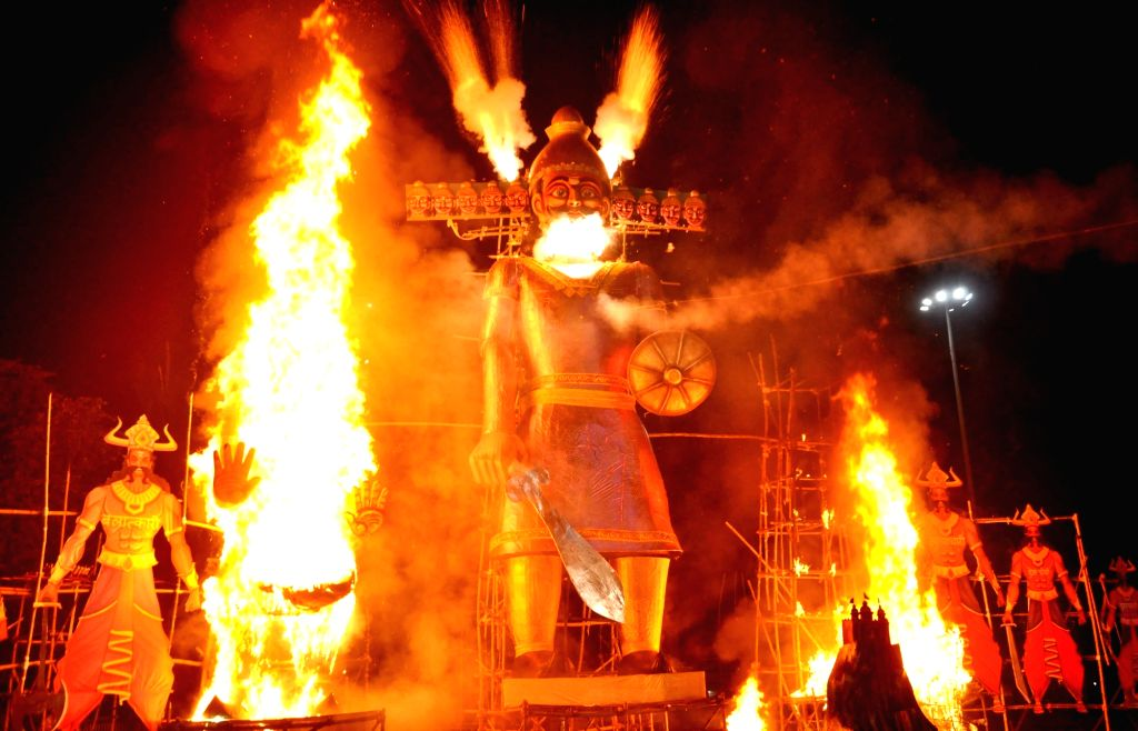 :Kolkata: Effigies of Ravana, Kumbhakarana and Meghanada being burnt in Salt Lake on Dussehra in Kolkata on Oct 19, 2018. .