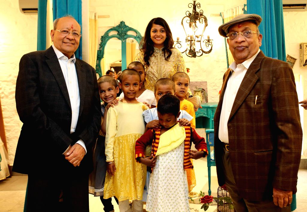 Emami Group Founders and Joint Chairmen R.S. Goenka and R.S. Agarwal at the inauguration of a multi-designer luxury kids' clothes and accessories store in Kolkata, on Jan 22, 2015. - S. Goenka