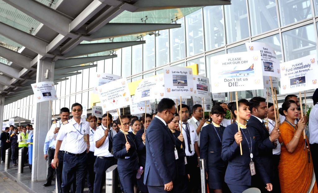 Kolkata: Employees of the debt-ridden Jet Airways stage a demonstration appealing the Central Government to save the airline, at Netaji Subhash Chandra Bose International Airport in Kolkata, on April 24, 2019. (Photo: Kuntal Chakrabarty/IANS)