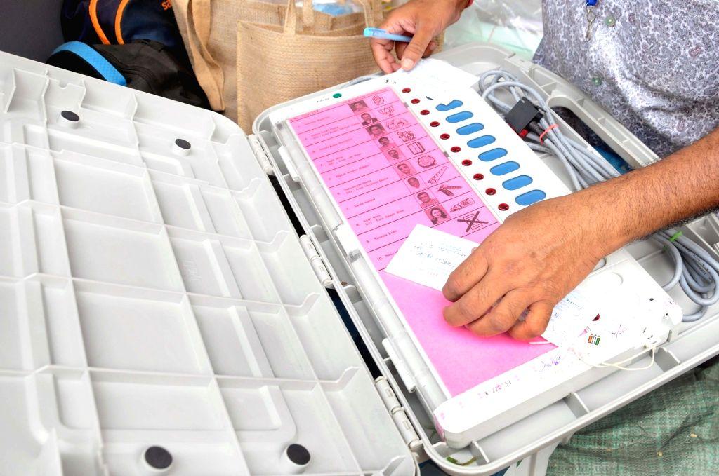 Kolkata: EVM distribution ahead of the 5th phase of State Assembly election at Bidhannagar College in Kolkata On Friday, 16th April,2021. (Photo:Kuntal Chakrabarty/IANS)